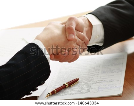 Handshake of business partners - stock photo
