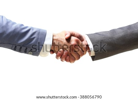 handshake of business partners after signing promising contract - stock photo