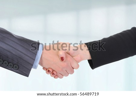 Handshake of business partners, men and women in the office - stock photo