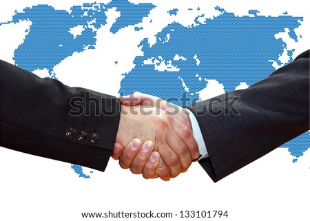 Handshake of business partners, over a map of the Earth. - stock photo