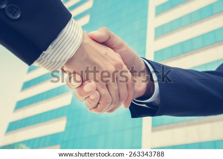 Handshake of businessmen, greeting,dealing & partnership concepts - vintage tone - stock photo