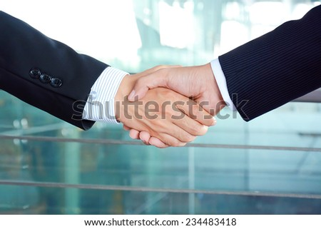 Handshake of businessmen - success, congratulation, greeting & business partner concepts - stock photo