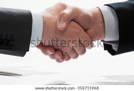 Handshake of successful business partners after meeting