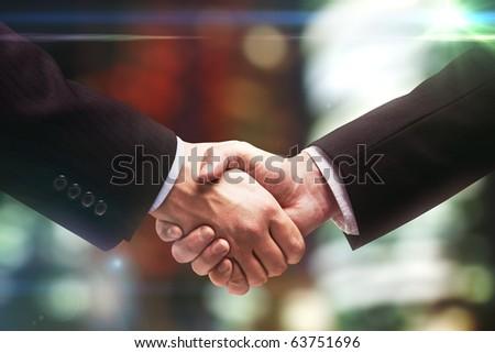 handshake of two business people - stock photo