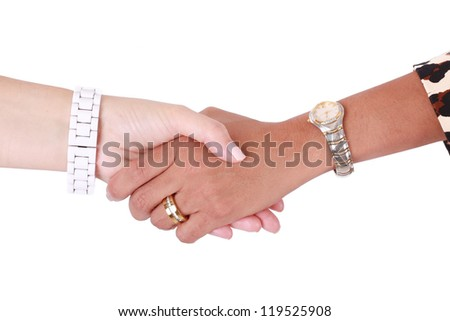 Handshake of two multiracial business women. Isolated on white background - stock photo