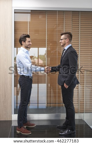 Handshake of two young businessmen