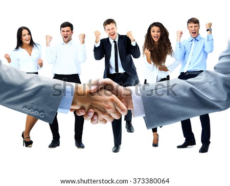 handshake on a background of a happy group of people - stock photo