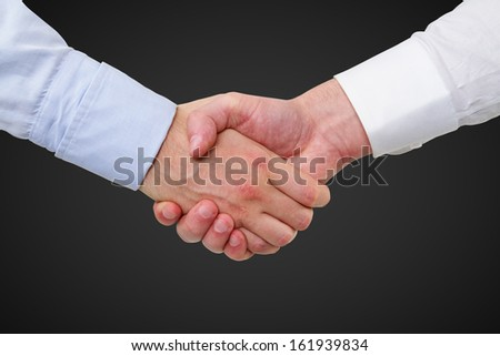 handshake on a black background - stock photo
