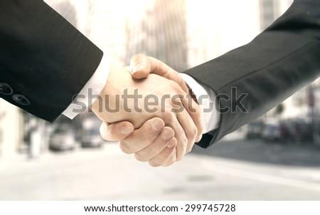 handshake on a city background - stock photo