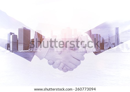 handshake on a city background, double exposure - stock photo