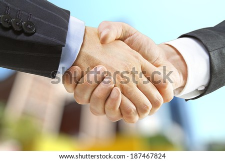 handshake on a skyscraper background