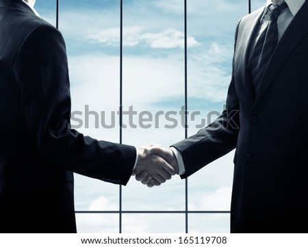 handshake on a window background