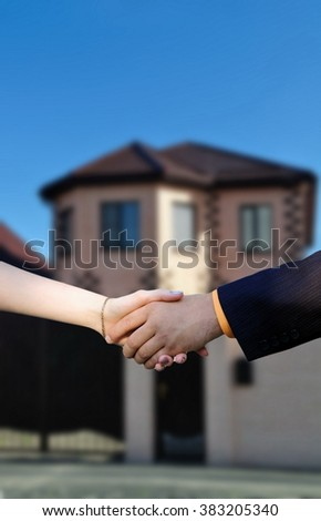 handshake on the background of a new home
