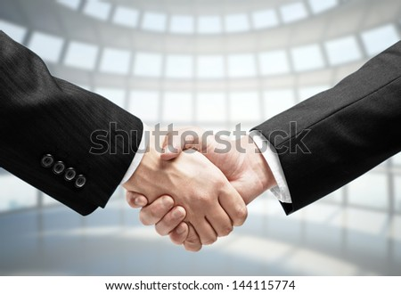 handshake on the background of modern office