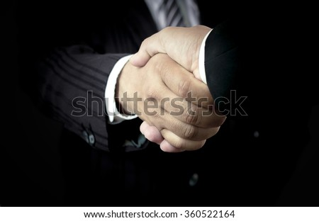 Handshake Partner Reliable Solidarity Welcome Advocacy Day CSR Service Synergy Trust Investment Committed Market Office Manager Suit Support Risk Work Agree Equity Final World Firm Credit Chum concept - stock photo