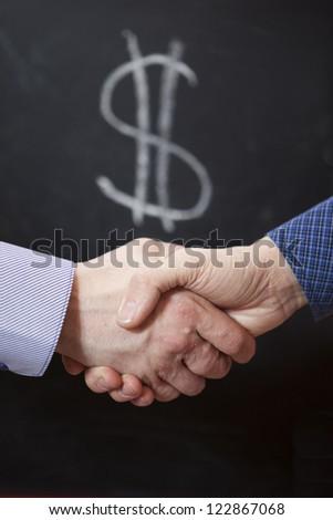 Handshake partners on a black background. - stock photo