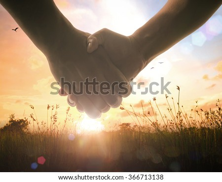 Handshake symbol forming a heart over blurred meadow sunset background. Valentine Ecology World Environment Day CSR Cancer Trust Hope Love Eco Friendly Arbor Mother Earth Business Unity Life concept. - stock photo