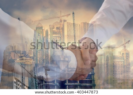 handshake two businessmen with construction sites background