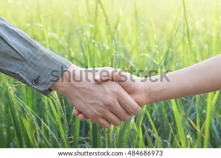 Handshake with nature green background