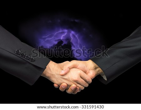 Handshake with storm background in business concept canceled - stock photo