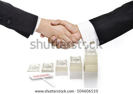 handshaking over growing money and success sign