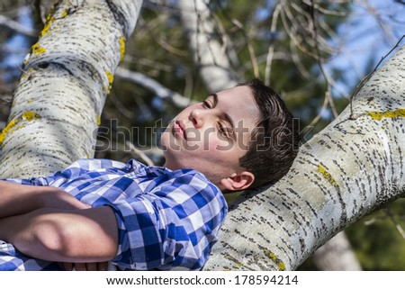 Handsome.A young boy dressed in western attire, outdoor park, summer - stock photo