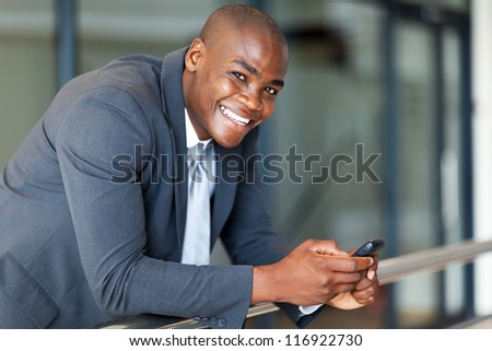 handsome african american business executive with smart phone - stock photo