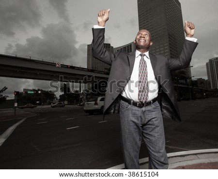 Handsome African American Businessman extending his arms in happiness n