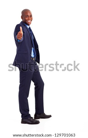 handsome african american businessman in suit giving thumb up