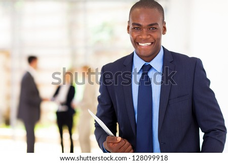 handsome african american businessman with tablet computer in office - stock photo