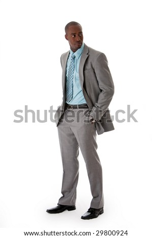 Handsome African American man in gray suit with smile standing with hands in pocket, isolated - stock photo