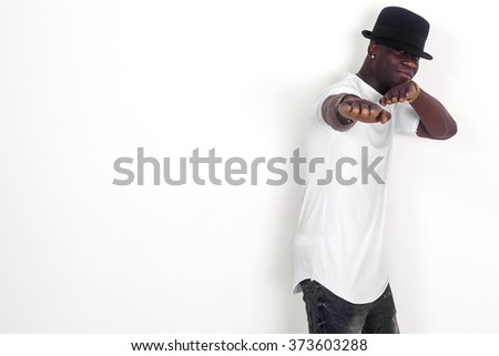Handsome african man portrait wearing shirt and hat and gesturing