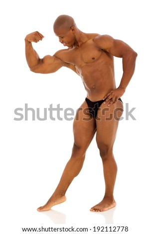 handsome afro american bodybuilder flexing muscles - stock photo