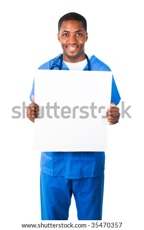 Handsome Afro-American doctor wearing scrubs and showing a white card - stock photo