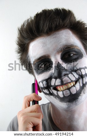 handsome and creepy skeleton guy in the middle of a creepy conversation - stock photo