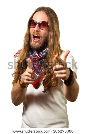 Handsome and funny man dressed like a hippie pointing towards the camera. Isolated on white. - stock photo