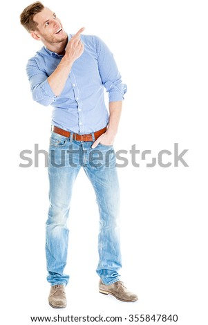 Handsome and sportive young man pointing at empty copyspace, isolated on white - Much room for your own text