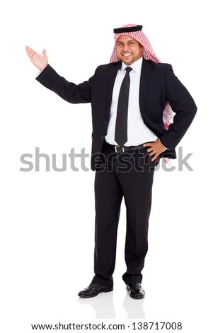 handsome arab businessman presenting on white copy space - stock photo