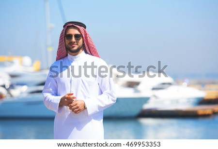 Handsome Arabian man at the yacht harbor