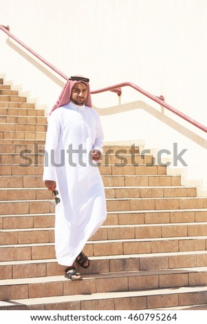 Handsome arabian man going downstairs