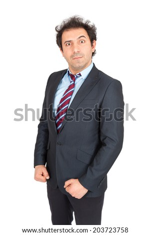 Handsome arabic man doing different expressions in different sets of clothes: angry - stock photo