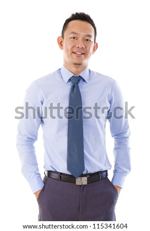 Handsome Asian businessman hand in pocket standing over white background. - stock photo