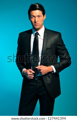 Handsome asian man in suit. Summer fashion. Studio shot. - stock photo