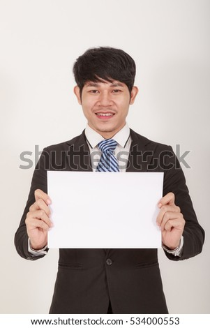 Handsome Asian Man Standing Holding Blank Paper