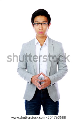Handsome asian man standing over white background - stock photo