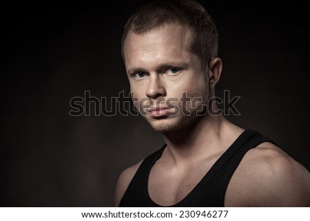 Handsome athlete on a black background