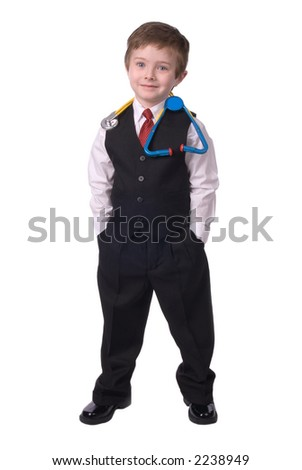 handsome attractive young boy dressed as a Doctor- in suit with stethescope on white background.