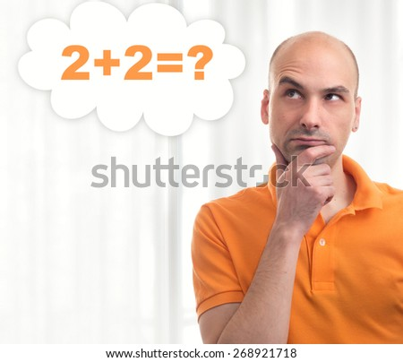 handsome bald man thinks in his mind - stock photo