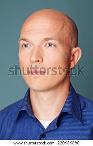Handsome   bald man wearing blue skirt - stock photo
