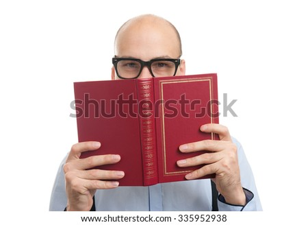 handsome bald man wearing bow tie and suspenders and reading a book - stock photo
